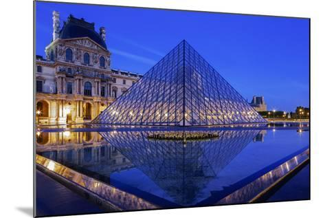 The Louvre Pyramid and Palace Reflected in a Still Pool Within the Napoleon Courtyard at Twilight-Garry Ridsdale-Mounted Photographic Print