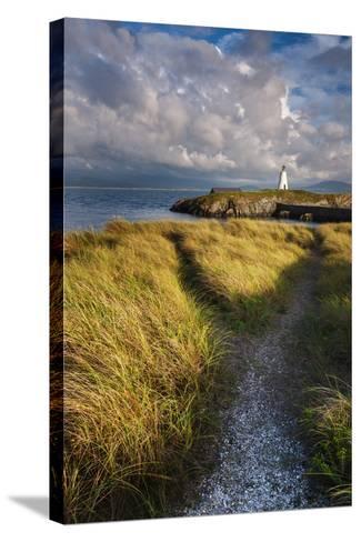 A Coastal Path Leading to Twr Mawr Lighthouse on Llanddwyn Island, Anglesey, Wales-Garry Ridsdale-Stretched Canvas Print