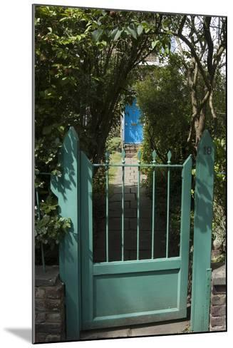 Front Gates with a Path Leading to a Blue Door, of a Residential House-Natalie Tepper-Mounted Photo