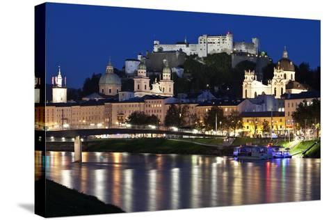 City at Night of Salzach River with Churches of Salzburg and Hohensalzburg Fortress, Austria-Julian Castle-Stretched Canvas Print