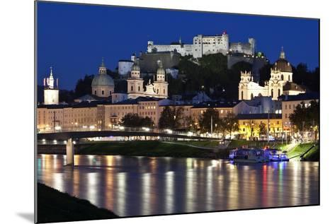 City at Night of Salzach River with Churches of Salzburg and Hohensalzburg Fortress, Austria-Julian Castle-Mounted Photo