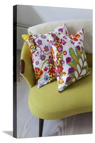 Floral Cushions on Retro Sofa in Living Room of London Family Home, UK-Pedro Silmon-Stretched Canvas Print