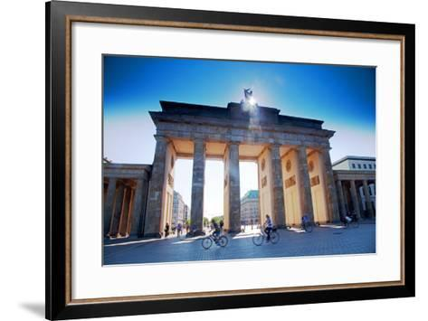 Germany, Berlin. Cyclists Passing under the Brandenburg Gate-Ken Scicluna-Framed Art Print