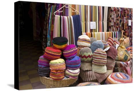 Fabrics, Tapestries, Cushions and Knitted Hats for Sale in the Souk, Essaouira, Morocco-Natalie Tepper-Stretched Canvas Print