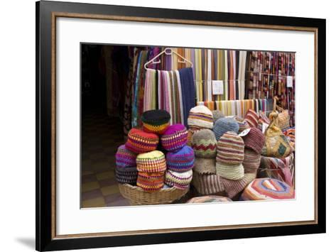 Fabrics, Tapestries, Cushions and Knitted Hats for Sale in the Souk, Essaouira, Morocco-Natalie Tepper-Framed Art Print