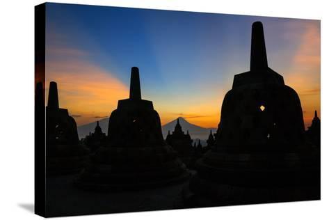 Indonesia, Java, Borobudur. Sunrise over the Active Stratovolcano-Nigel Pavitt-Stretched Canvas Print