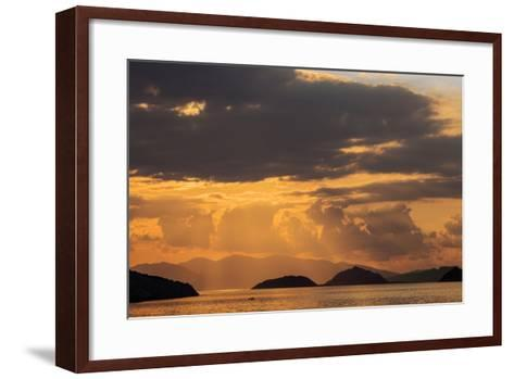 Indonesia, Lesser Sunda Islands, Rinca. Sunset over Komodo Island.-Nigel Pavitt-Framed Art Print