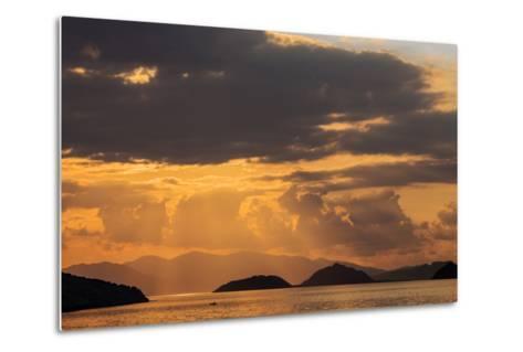 Indonesia, Lesser Sunda Islands, Rinca. Sunset over Komodo Island.-Nigel Pavitt-Metal Print