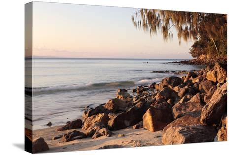 Warm Glow of Sunset on a Boulder-Strewn Beach on Noosa Heads, the Sunshine Coast, Queensland-William Gray-Stretched Canvas Print