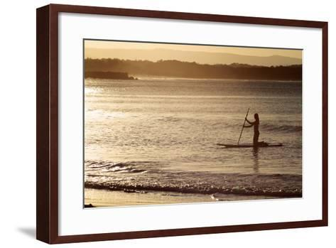 A Woman on a Stand-Up Paddleboard Heads Towards Main Beach, Noosa, at Sunset-William Gray-Framed Art Print