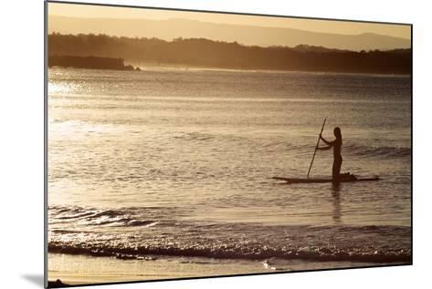 A Woman on a Stand-Up Paddleboard Heads Towards Main Beach, Noosa, at Sunset-William Gray-Mounted Photographic Print
