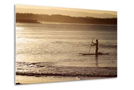 A Woman on a Stand-Up Paddleboard Heads Towards Main Beach, Noosa, at Sunset-William Gray-Metal Print