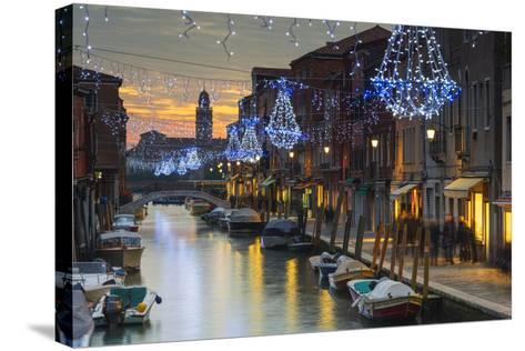 Europe, Italy, Veneto, Venice, Murano, Christmas Decoration on a Canal-Christian Kober-Stretched Canvas Print
