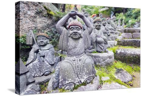 Asia, Japan, Honshu, Hiroshima Prefecture, Miyajima Island, Statues in Daisho in Temple-Christian Kober-Stretched Canvas Print