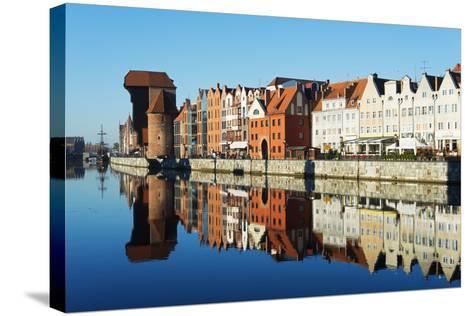 Europe, Poland, Gdansk, Canal Side Houses and Gdansk Crane-Christian Kober-Stretched Canvas Print
