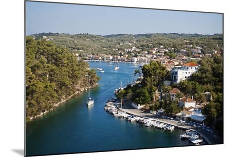 Greece, Paxos. Yachts and Pleasure Boats Moored in the Entrance to Gaios Harbour-John Warburton-lee-Mounted Photographic Print
