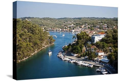 Greece, Paxos. Yachts and Pleasure Boats Moored in the Entrance to Gaios Harbour-John Warburton-lee-Stretched Canvas Print