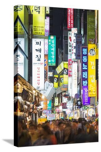Asia, Republic of Korea, South Korea, Seoul, Neon Lit Streets of Myeong-Dong-Christian Kober-Stretched Canvas Print