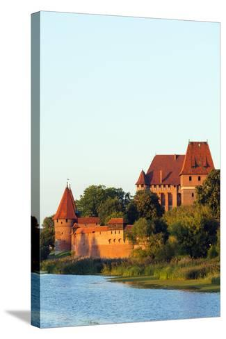 Europe, Poland, Pomerania, Medieval Malbork Castle, Marienburg Fortress of Mary, UNESCO Site-Christian Kober-Stretched Canvas Print