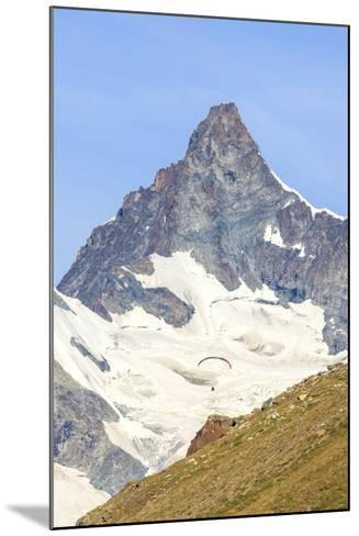 A Paraglider Flies in Front of the Majestic Obergabelhorn, Pennine Alps, Swiss Alps-Roberto Moiola-Mounted Photographic Print