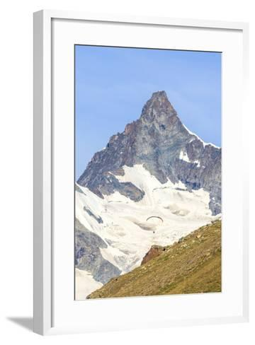 A Paraglider Flies in Front of the Majestic Obergabelhorn, Pennine Alps, Swiss Alps-Roberto Moiola-Framed Art Print