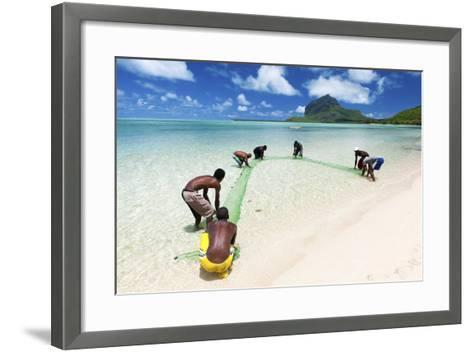 Fisherman on a Beach Being Overlooked by the Basaltic Monolith, Indian Ocean-Jordan Banks-Framed Art Print
