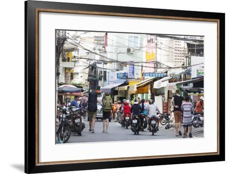 Backpackers on City Street, Ho Chi Minh City (Saigon), Vietnam, Indochina, Southeast Asia, Asia-Christian Kober-Framed Art Print