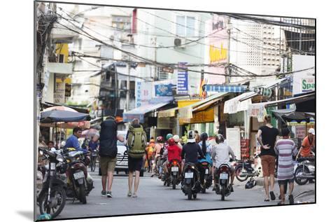 Backpackers on City Street, Ho Chi Minh City (Saigon), Vietnam, Indochina, Southeast Asia, Asia-Christian Kober-Mounted Photographic Print