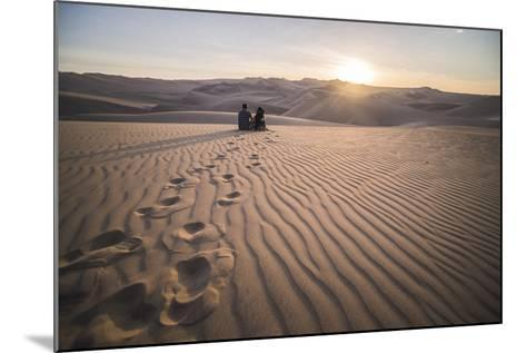 Couple Watching the Sunset over Sand Dunes in the Desert at Huacachina, Ica Region, Peru-Matthew Williams-Ellis-Mounted Photographic Print