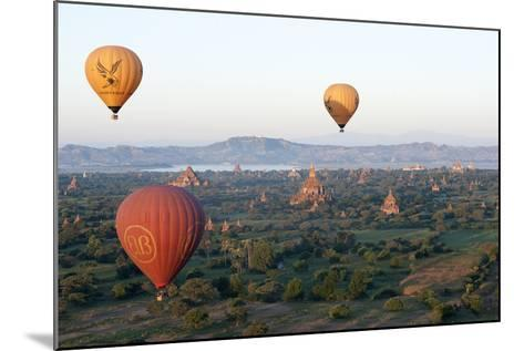 Hot Air Balloons Flying over the Terracotta Temples of Bagan-Annie Owen-Mounted Photographic Print