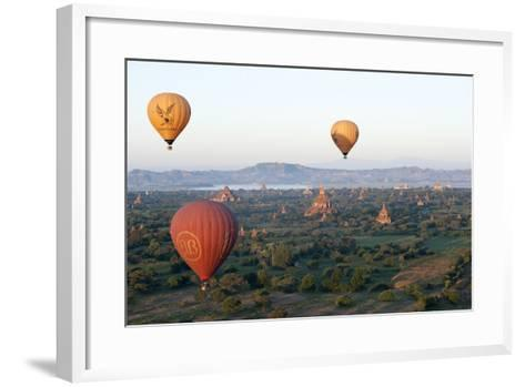 Hot Air Balloons Flying over the Terracotta Temples of Bagan-Annie Owen-Framed Art Print