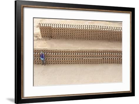 Female Brick Worker Standing Beside Hand Made Bricks Stacked to Dry before Baking, Rajasthan, India-Annie Owen-Framed Art Print