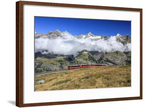 The Bahn Train on its Route with High Peaks and Mountain Range in the Background, Switzerland-Roberto Moiola-Framed Art Print