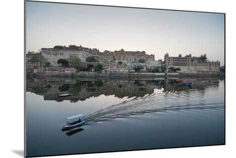 A Water Taxi Passing City Palace Reflected in Still Dawn Waters of Lake Pichola, Rajasthan, India-Martin Child-Mounted Photographic Print