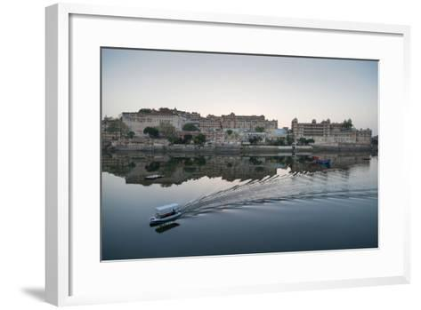 A Water Taxi Passing City Palace Reflected in Still Dawn Waters of Lake Pichola, Rajasthan, India-Martin Child-Framed Art Print