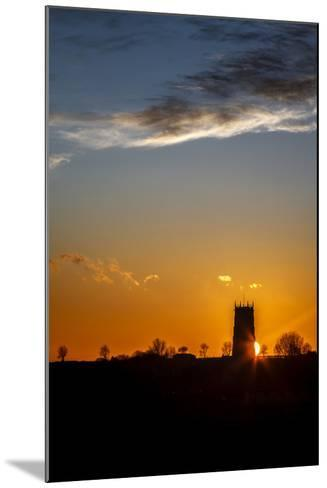 Sunset Behind the Parish Church of the Holy Trinity and All Saints at Winterton on Sea, England-Andrew Sproule-Mounted Photographic Print