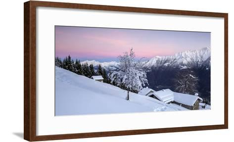 Pink Sky at Dawn Above Snow Covered Huts and Trees, Orobie Alps-Roberto Moiola-Framed Art Print
