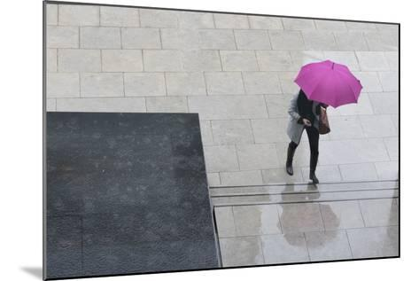 Woman with Umbrella and Mobile Phone Walking Up Steps to Auckland Art Gallery-Nick Servian-Mounted Photographic Print