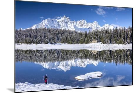 Hiker Admires the Snowy Peaks and Woods Reflected in Lake Palu, Malenco Valley, Valtellina, Italy-Roberto Moiola-Mounted Photographic Print