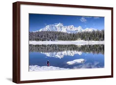 Hiker Admires the Snowy Peaks and Woods Reflected in Lake Palu, Malenco Valley, Valtellina, Italy-Roberto Moiola-Framed Art Print