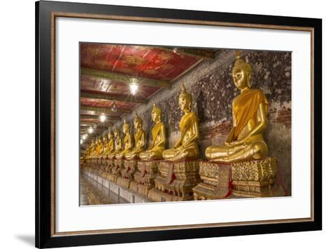Rows of Gold Buddha Statues, Wat Suthat Temple, Bangkok, Thailand, Southeast Asia, Asia-Stephen Studd-Framed Art Print