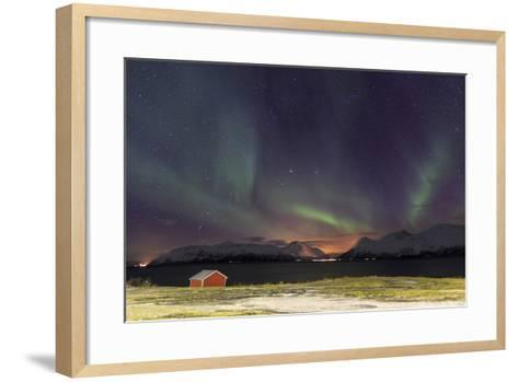 Northern Lights Illuminates the Wooden Cabin at Svensby, Lyngen Alps, Troms, Lapland, Norway-Roberto Moiola-Framed Art Print