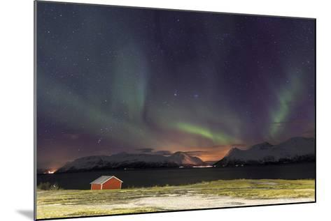 Northern Lights Illuminates the Wooden Cabin at Svensby, Lyngen Alps, Troms, Lapland, Norway-Roberto Moiola-Mounted Photographic Print