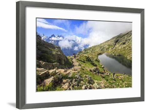 Low Clouds and Mist around Grandes Jorasses While Hikers Proceed on Lac De Cheserys, French Alps-Roberto Moiola-Framed Art Print