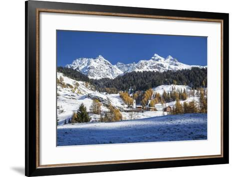 Snowy Landscape and Colorful Trees in the Small Village of Sur, Canton of Graubunden, Switzerland-Roberto Moiola-Framed Art Print