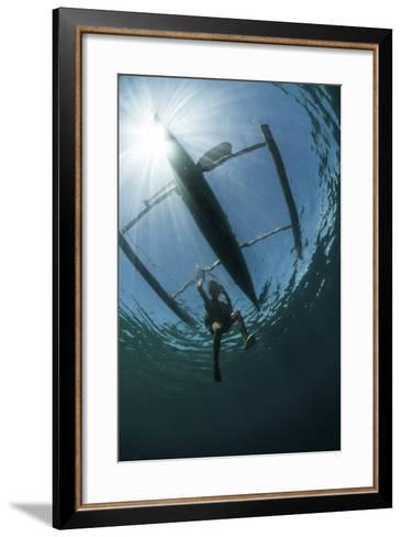 A Fisherman Uses a Wooden Outrigger Near a Remote Island in Indonesia-Stocktrek Images-Framed Art Print