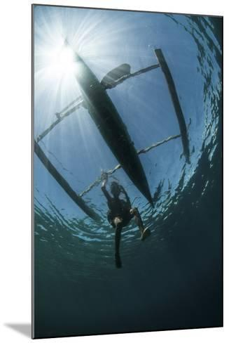 A Fisherman Uses a Wooden Outrigger Near a Remote Island in Indonesia-Stocktrek Images-Mounted Photographic Print