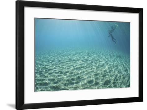 A Diver Hovers Above a Sandy Slope Off the Island of Guadalcanal-Stocktrek Images-Framed Art Print