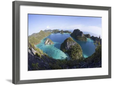 Limestone Islands Surround a Lagoon in a Remote Part of Raja Ampat-Stocktrek Images-Framed Art Print