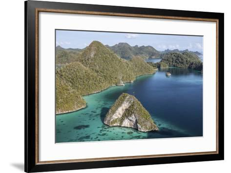 Forest-Covered Limestone Islands Surround a Lagoon in Raja Ampat-Stocktrek Images-Framed Art Print